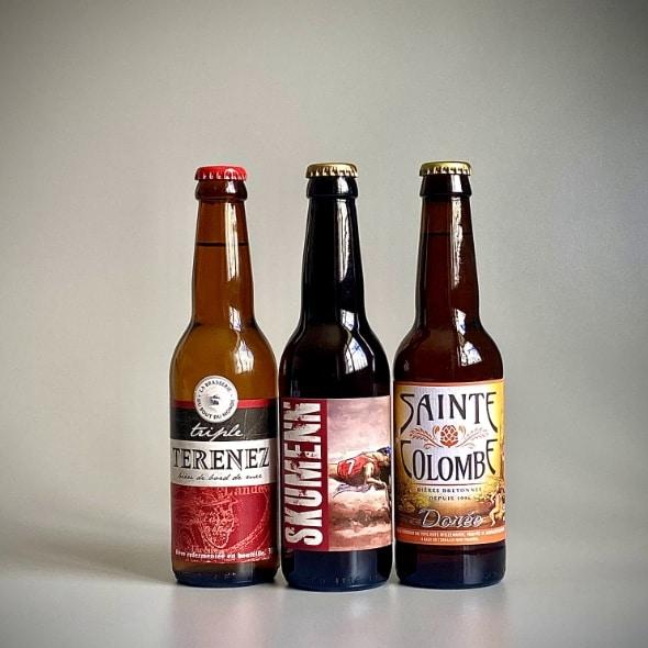 Photo de trois bouteilles de bières de 33 cl de 3 teintes