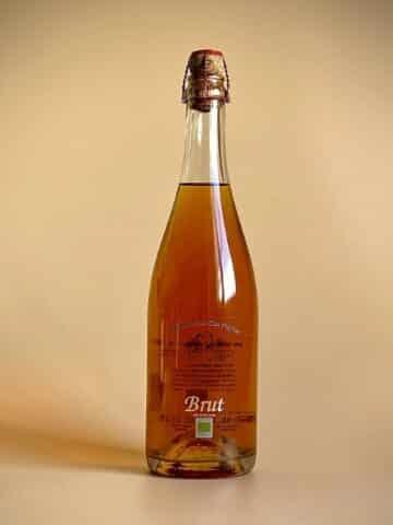 Photo d'une bouteille de cidre de 75 cl teinte blanche